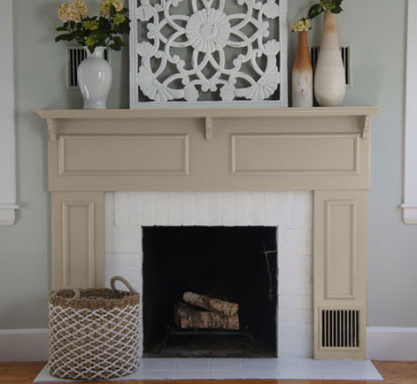 painting fireplaces.  Painting a Drab Fireplace With Modern Look Behr
