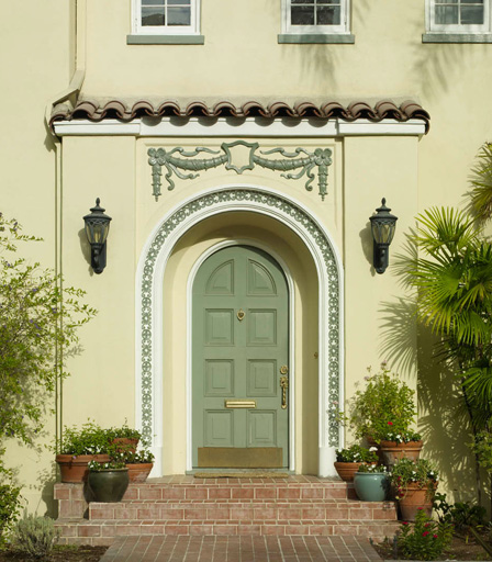 The overall styling of this front entryway reinforces the Mediterranean-influenced architecture of the home.