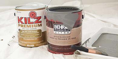 Latas de un galón de BEHR PREMIUM PLUS ULTRA Pintura y KILS Premium Imprimador