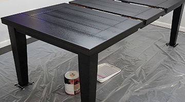 Table with the first coat of black paint