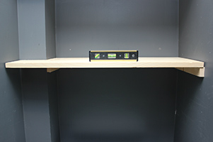 Lay shelf in place and check for level.