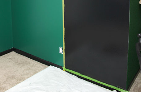 Green and black wall drying with painters tape