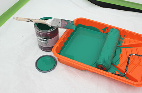 Green color with paint brush and Behr can
