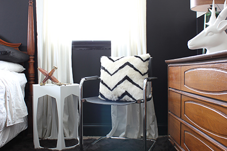 The solid white curtains and black-and-white pillow pick up the new color scheme