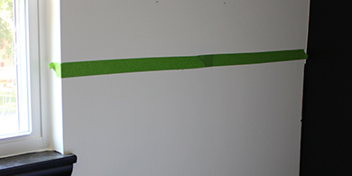Tape line across the wall to divide colors