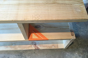 Make sure the shelf supports are square before attaching them