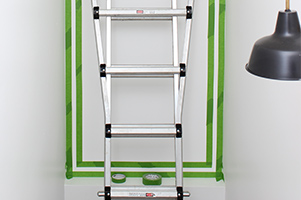 Use a ladder to tape and paint accent wall
