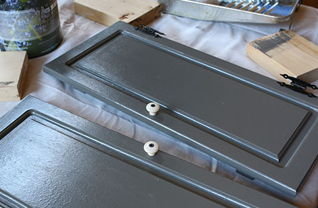 Add hardware back to the doors after the paint has had ample time to dry