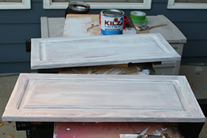 Priming the hutch doors with Kilz primer and a brush
