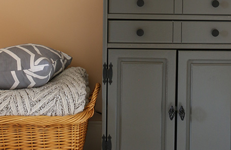 A wicker basket and new hardware accent the refreshed hutch