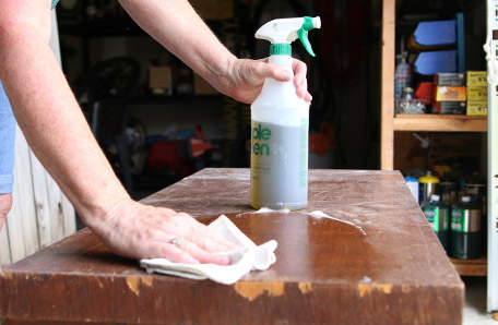 Cleaning the dresser with a rag and all-purpose cleaner