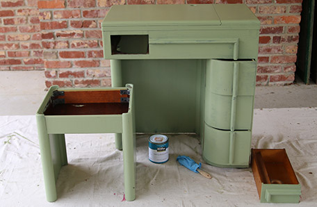 The desk and stool after one coat of paint