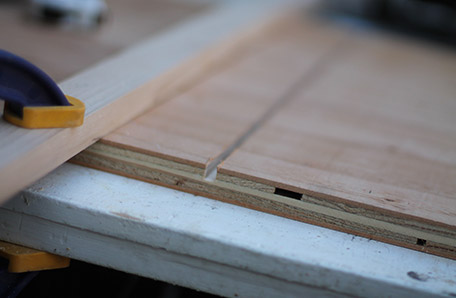 Use a straight edge and router to cut a groove in the plywood