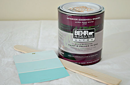 A quart of Behr paint alongside a paint chip