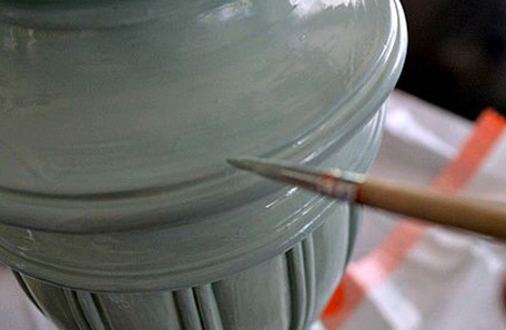 Lamp being painted with small brush