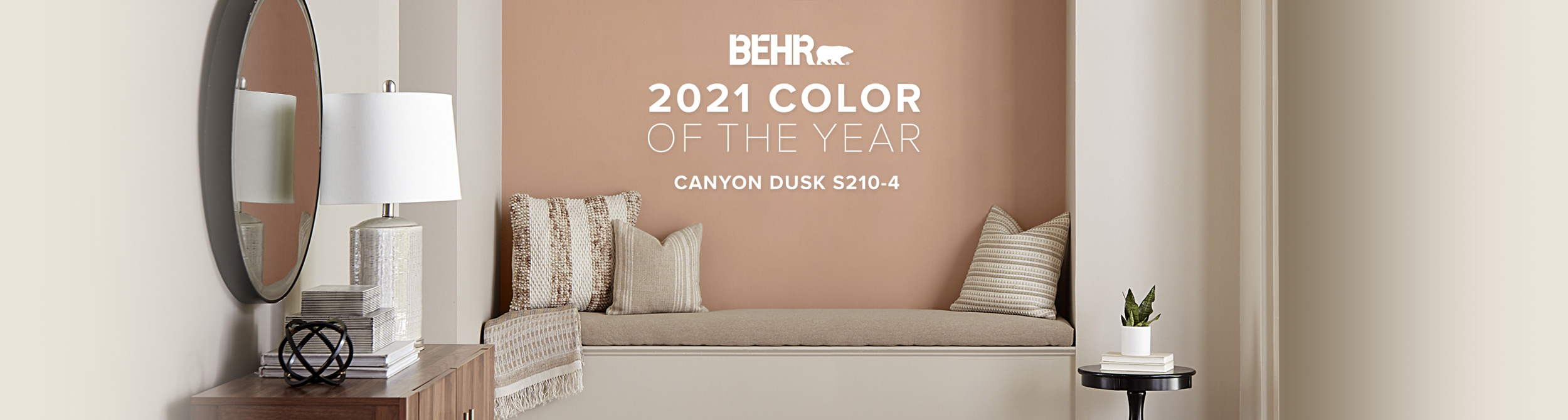 Banner image of reading nook painted in Canyon Dusk, featuring Behr Color of the Year.