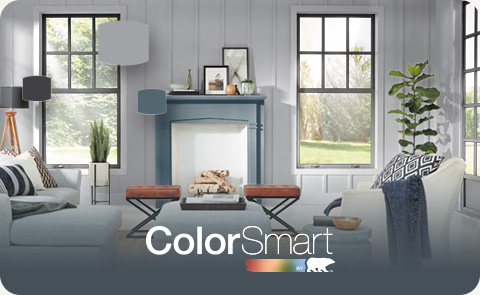 Painted living room with the ColorSmart by BEHR logo in the foreground