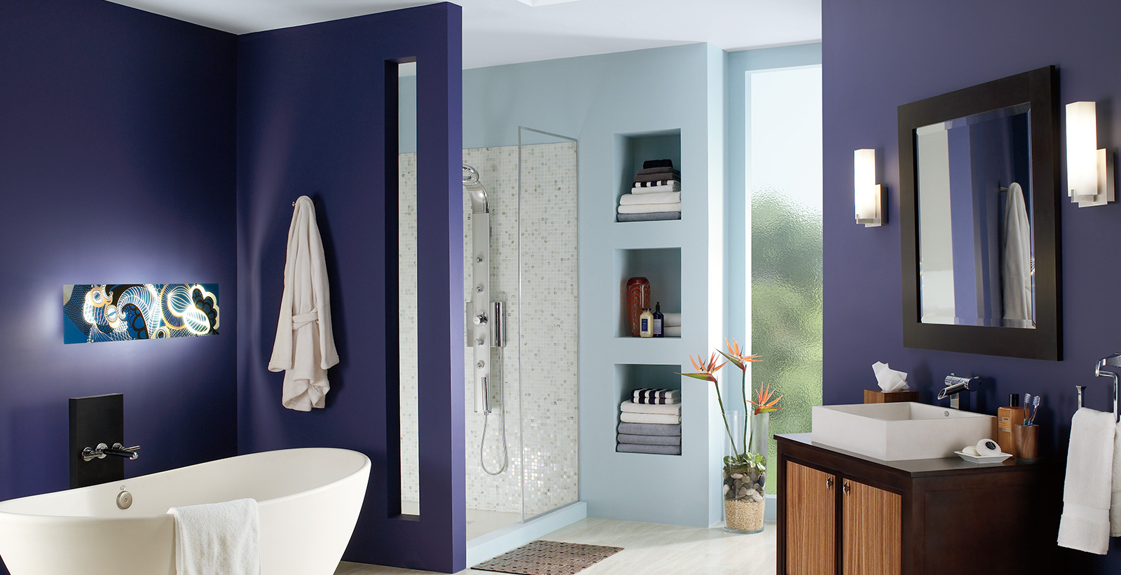 Bold and Dramatic styled bathroom with dark blue and light blue walls, white ceiling, and wooden vanity.
