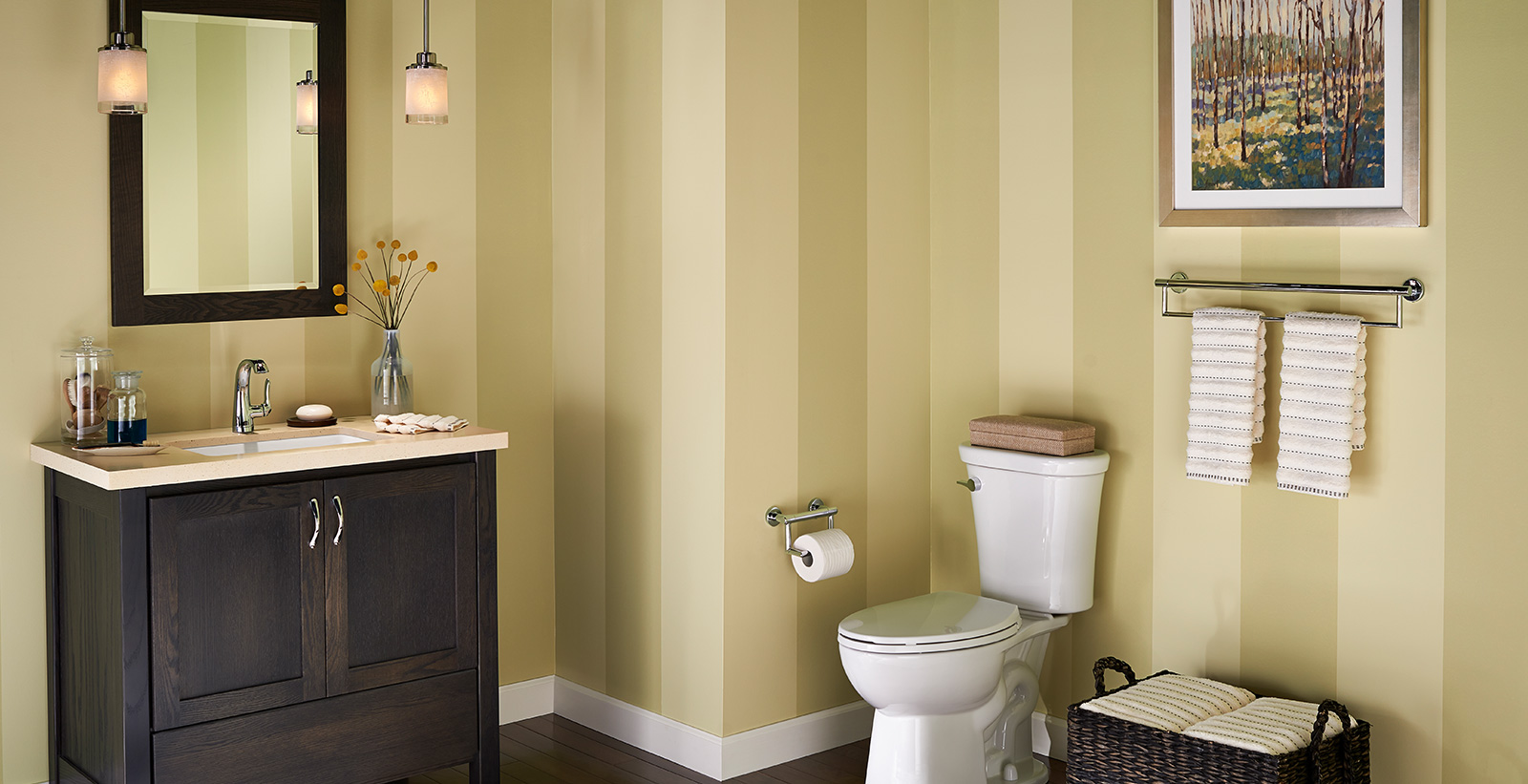 Soothing styled bathroom with light brown, white, brown vertically striped walls, and dark brown wooden vanity.