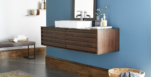 Modern styled bathroom with white and blue walls, and wooden trim.