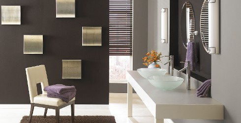 Modern and contemporary styled bathroom with brown wall, grey walls, and white trim.