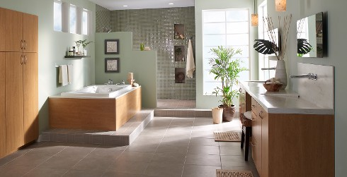 Modern and contemporary styled, tranquil bathroom with green walls, and white trim.