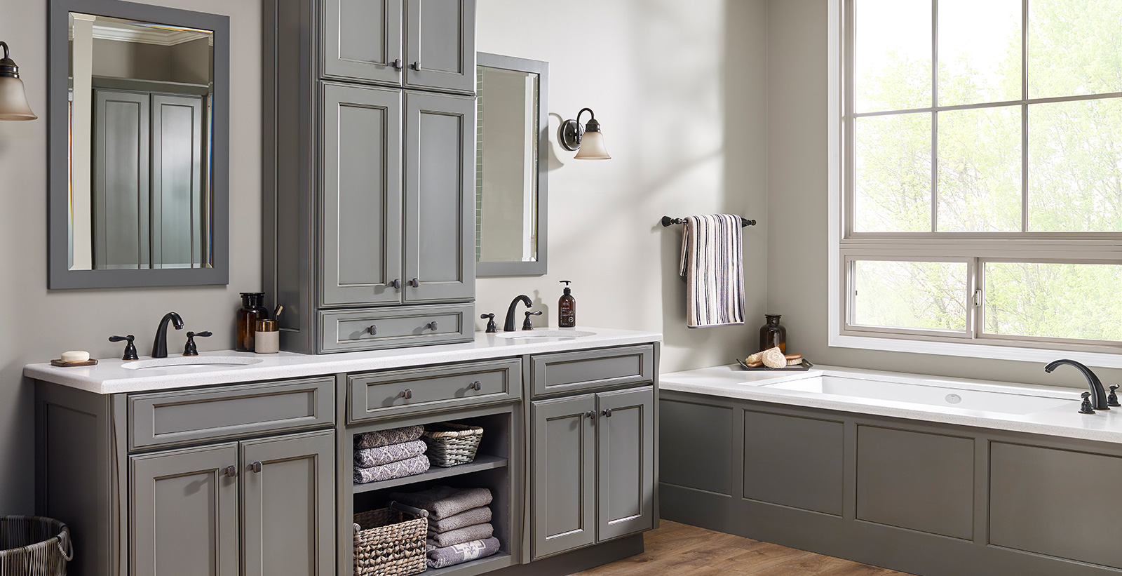 Versatile and comfortable styled bathroom with white walls and gray cabinets and trim.