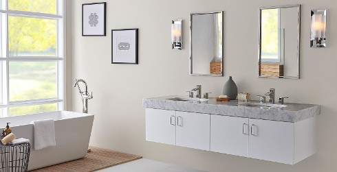 Versatile and comfortable styled, clean and sleek bathroom with white walls, and white cabinets and trim.