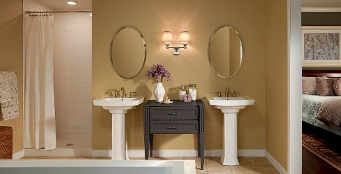 Lavish styled bathroom with yellow walls and white trim.