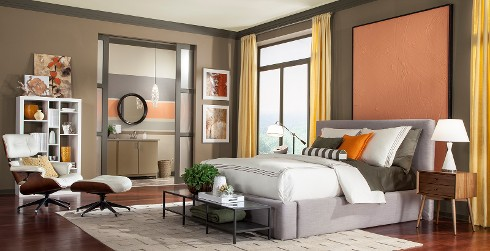 Contemporary styled bedroom with taupe on walls, dark brown on trim, and large salmon colored abstract painting on wall behind bed