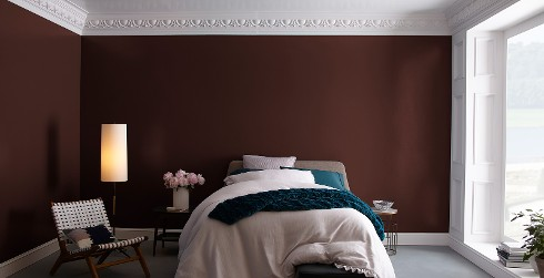 Classic bedroom with dark red on walls, white on ceiling and trim, and floor-to-ceiling window