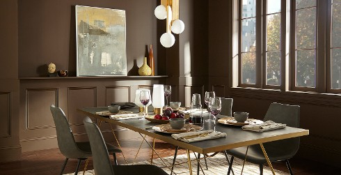 Contemporary dining room with warm mid-toned brown throughout, casual laminate table and suede side chairs.