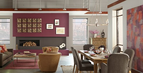 Open concept dining space with rich beet red on fireplace walls, creamy gray on main walls and brown gray as accent color.