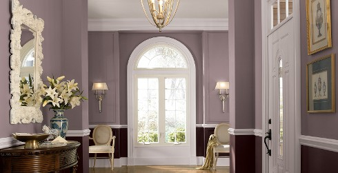 Hallway with plum purple wall, and white trim, rustic furniture, classic style.