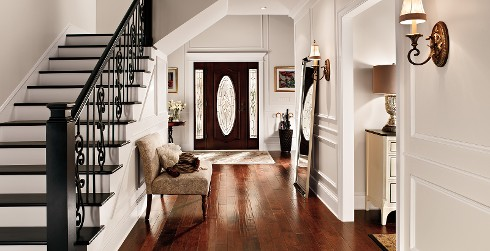 Hallway with stairs, off white walls, and white trim, classic style.