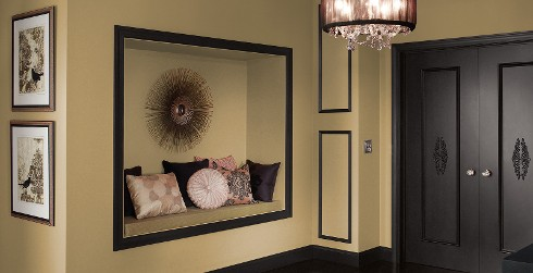 Hallway with light brown wall, and dark gray trim, eclectic style.