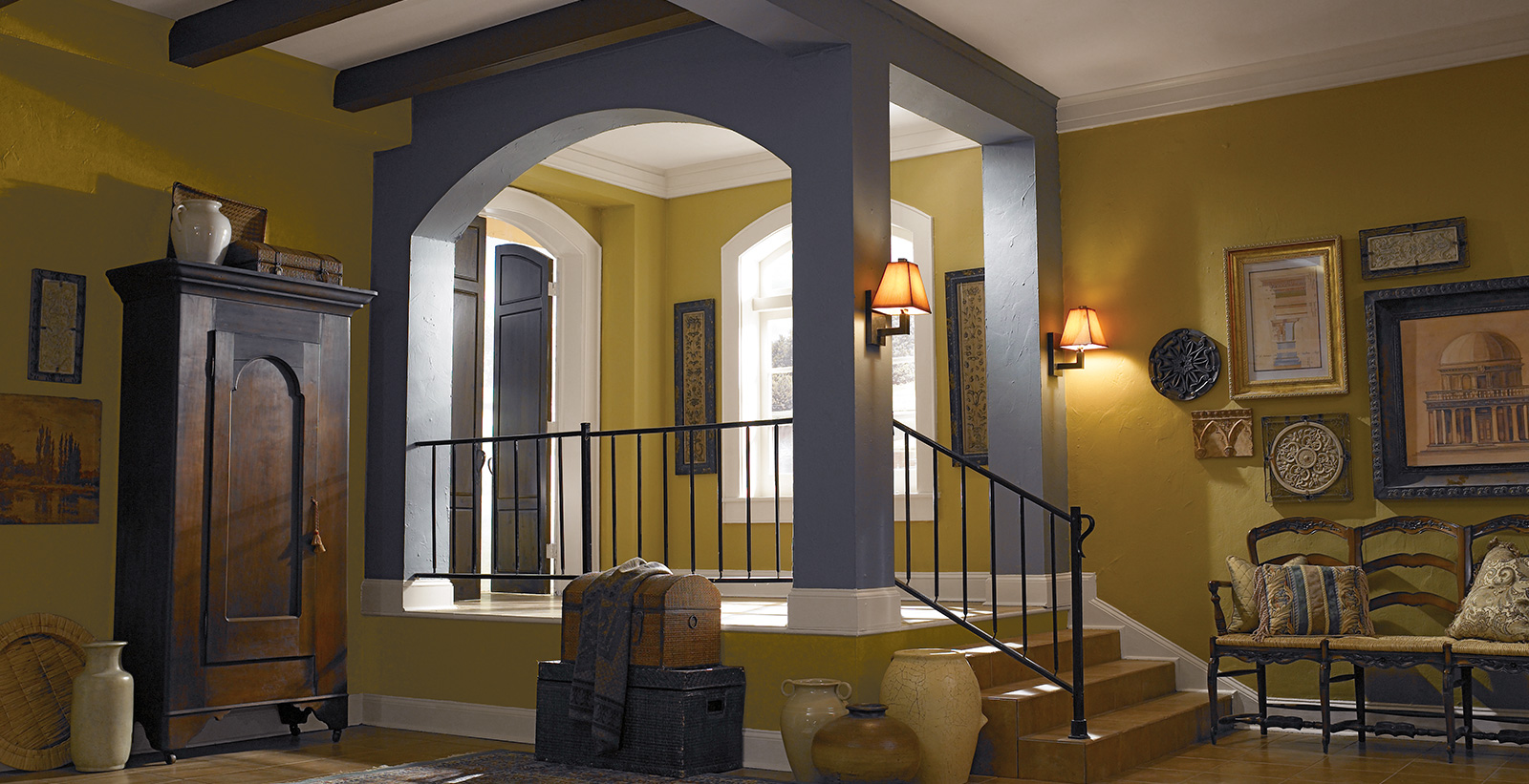 Hallway with yellow walls, blue accents, and white trim, eclectic style.