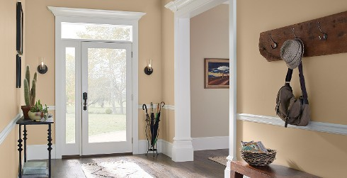Hallway with orange walls, and white trim, casual style.