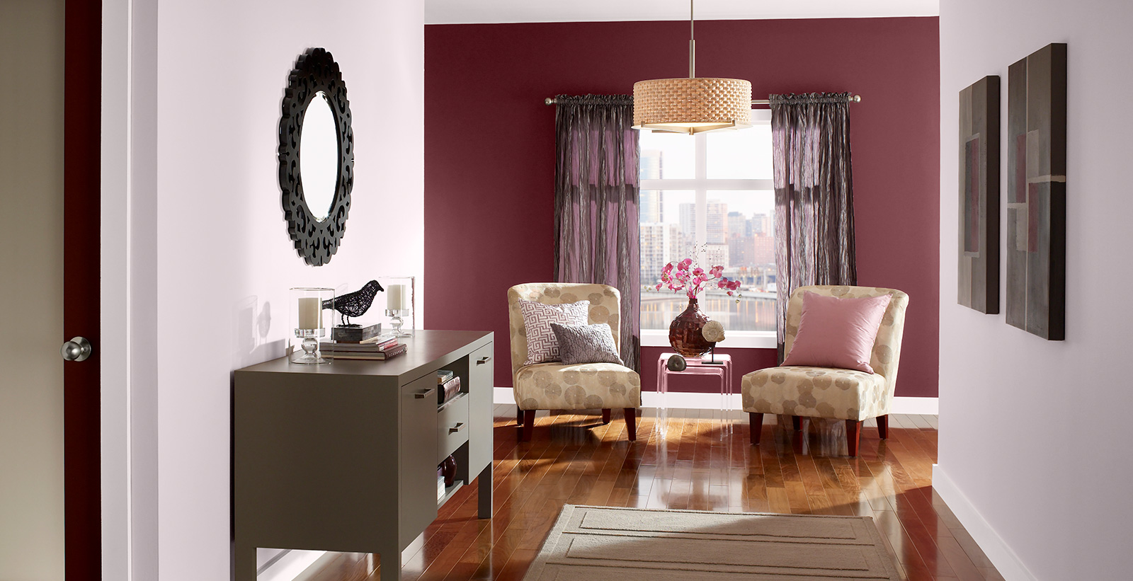 Hallway with light pink walls, dark red accent wall, and white trim.