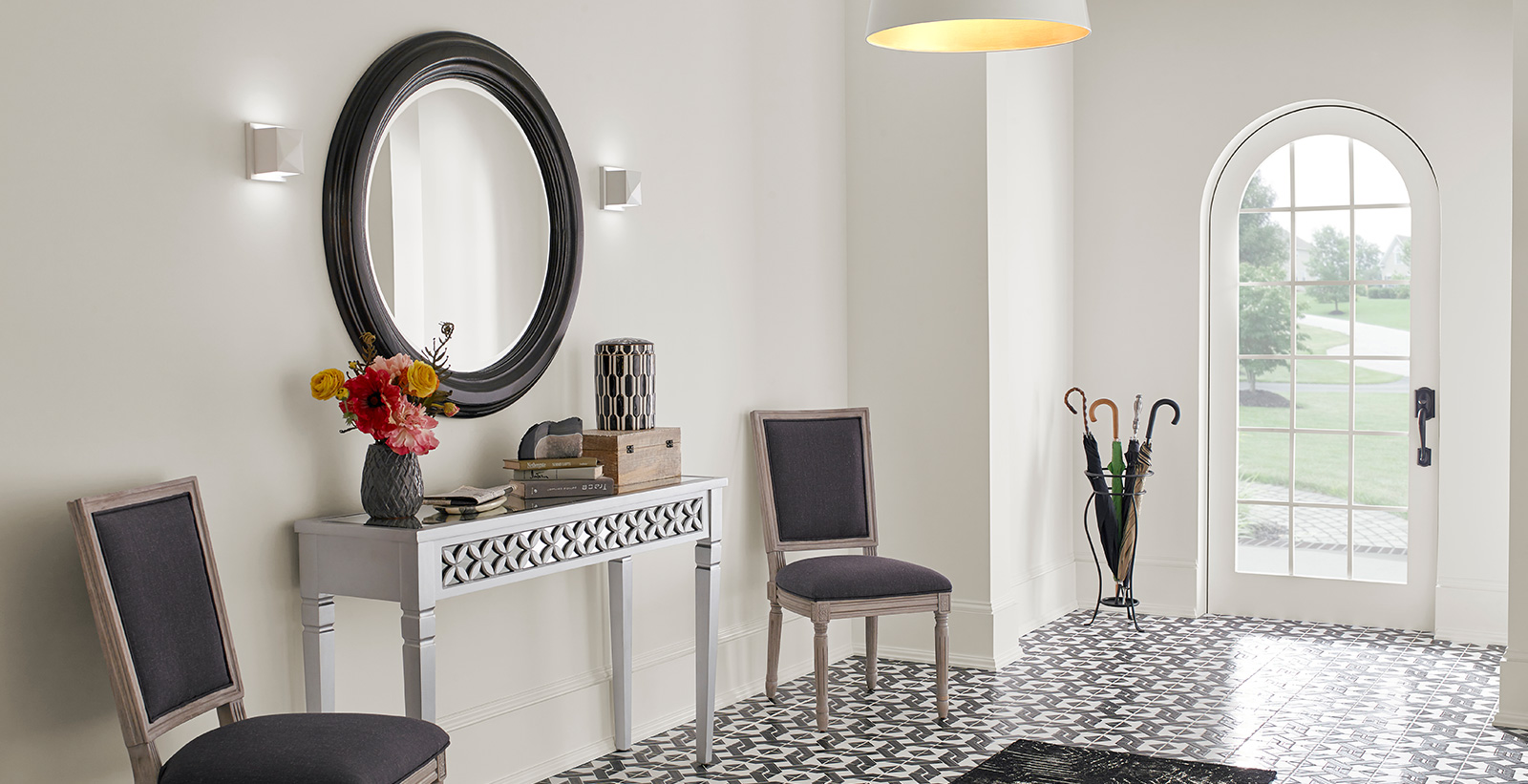 Hallway with white walls, and white trim, versatile and feminine style.