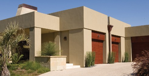 Modern themed house with light brown walls, and dark brown trim.