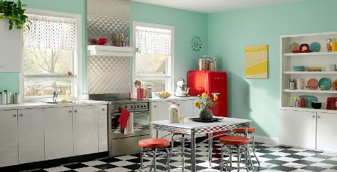 Retro kitchen with light blue on walls, white on cabinets and checkered flooring.
