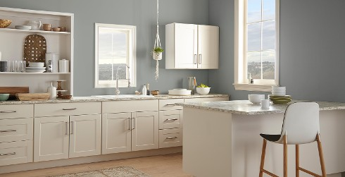 Casual kitchen with grayish blue on walls, white on cabinets, and granite counter tops