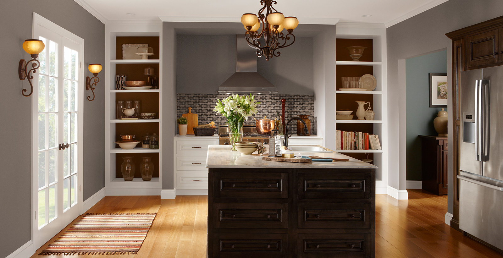 Traditional kitchen with gray on walls, white on trim and ceiling, and dark wood island