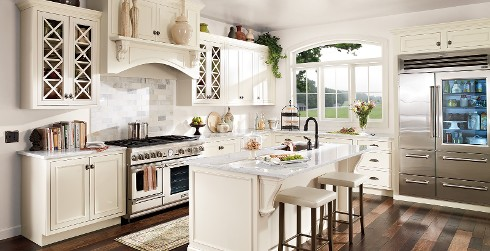 Classic kitchen with white on walls, off white on cabinetry, and granite counter tops