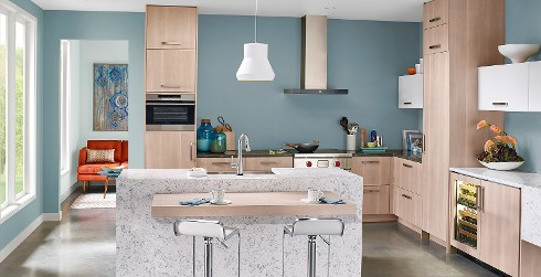 Modern kitchen with light blue on walls, white on ceiling and trim, and granite island and counter tops