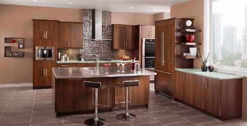 Contemporary kitchen with light brown on walls, brown wooden cabinets, and mosaic backsplash