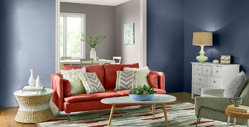 Mid-century living room with blue on walls, white on trim, and red couch