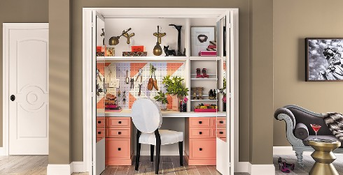 Office workspace closet with brown walls, and white trim, white desk with pink drawers, eclectic style.