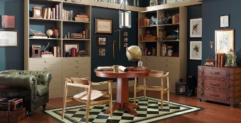 Rustic office workspace with blue walls, and white trim, wooden desk, eclectic style.